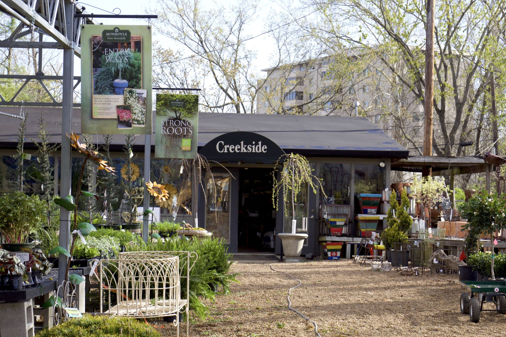 Flowers, plants and garden decorations lead to Creekside's storefront