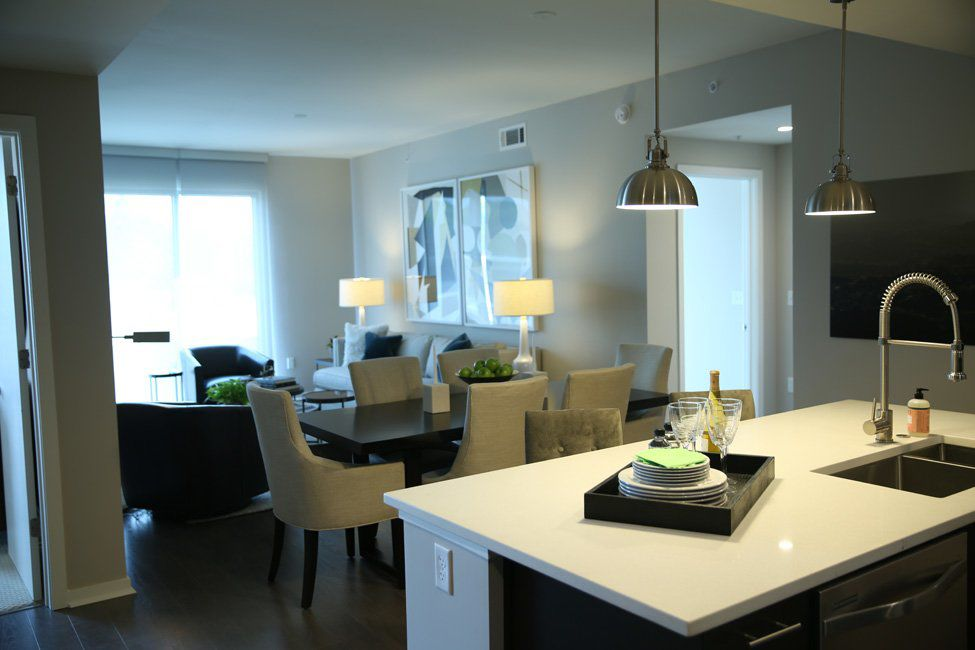 The living space is connected to the kitchen and dining area