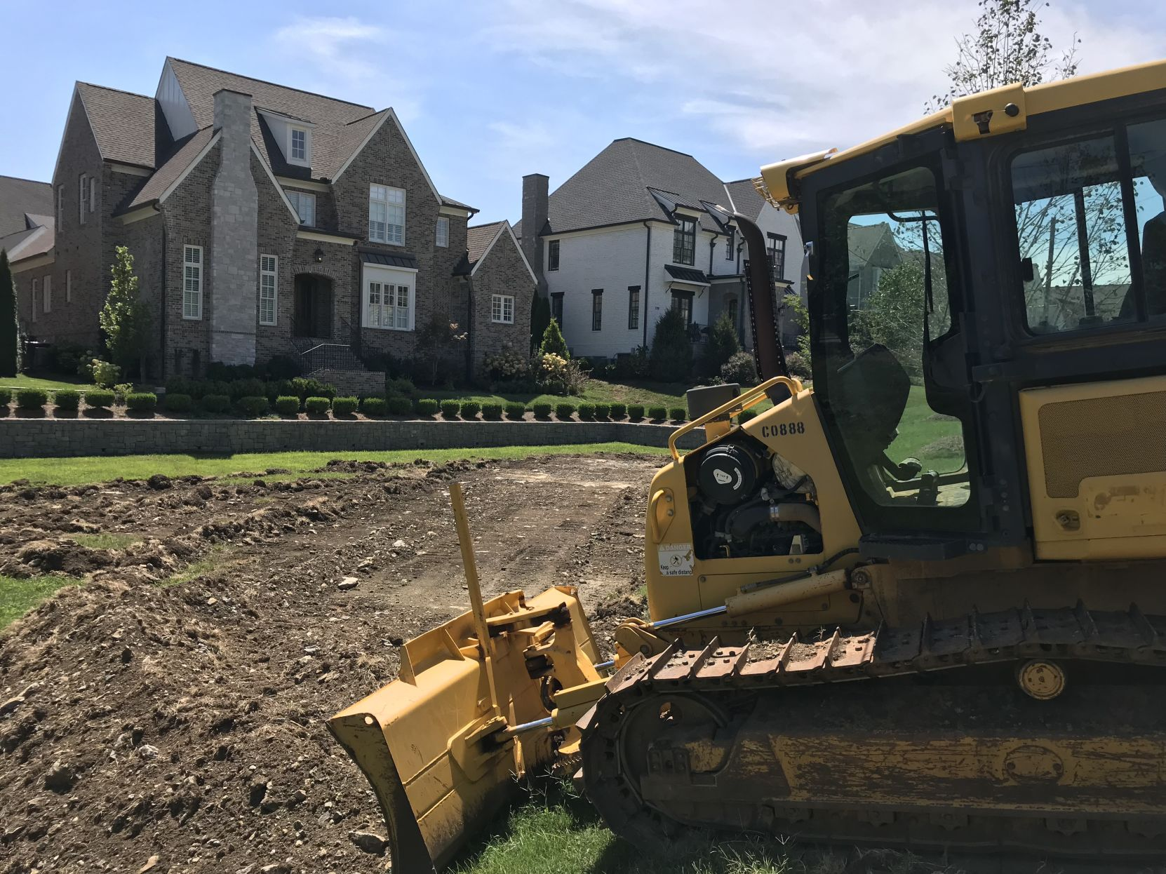<p>Construction equipment sits along Glen Echo Road near new construction homes in Green Hills (photography by Brian Goins)</p>
