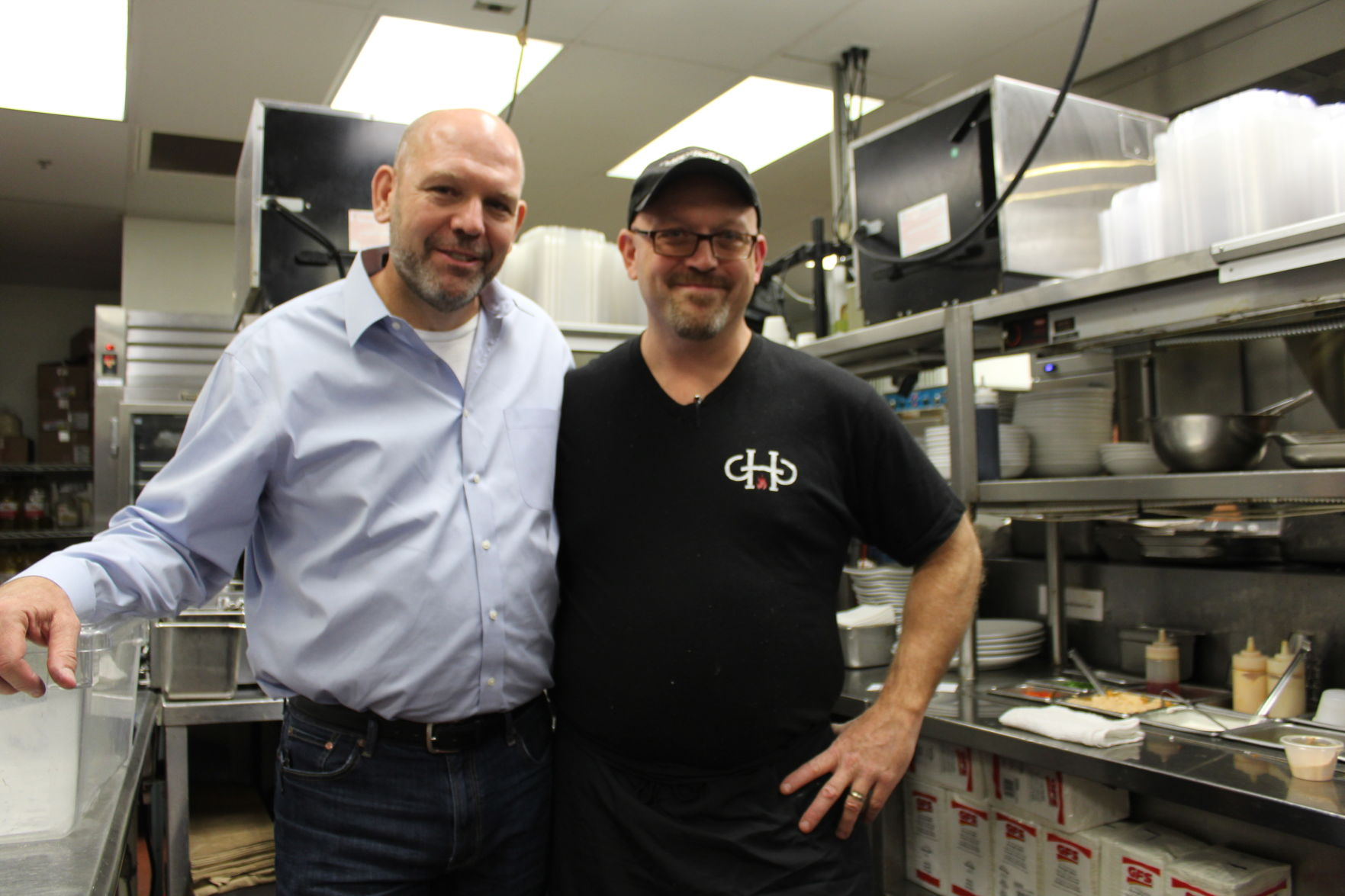<p>Green Hills Grille's owner Steven Smithing, left, and his broth- er Christopher Smithing, worked at the original location before it closed in 2008. Christopher now serves as head chef. Photo by Rover/Dylan Skye Aycock</p>