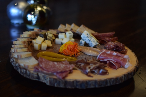 A board of prepared meats and cheeses from Great Scott.