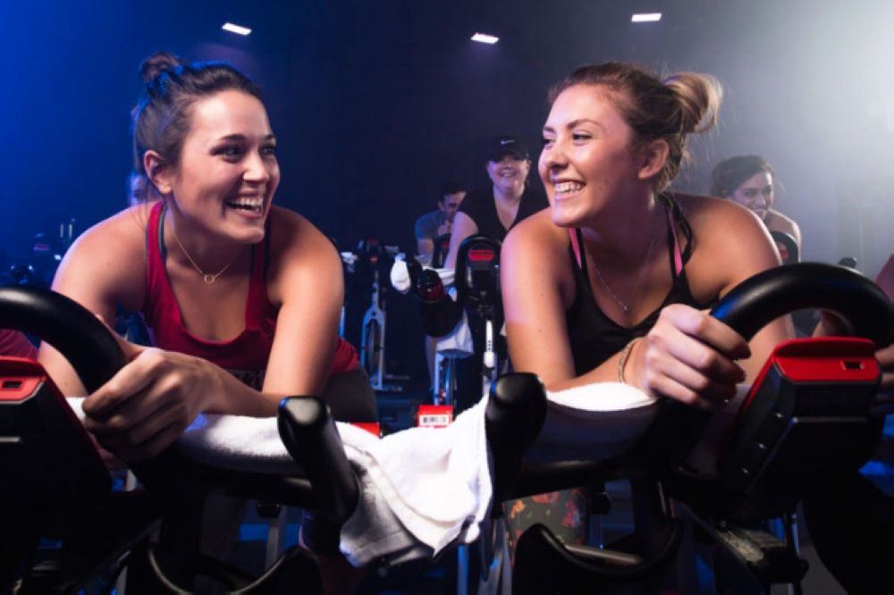 Women on fitness bicycles