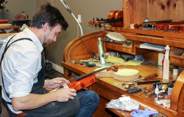 Violin maker Zach Johnson studied in one of three schools in the U.S. offering a violin-making program. (Nola Z. Valente/Community Impact Newspaper)