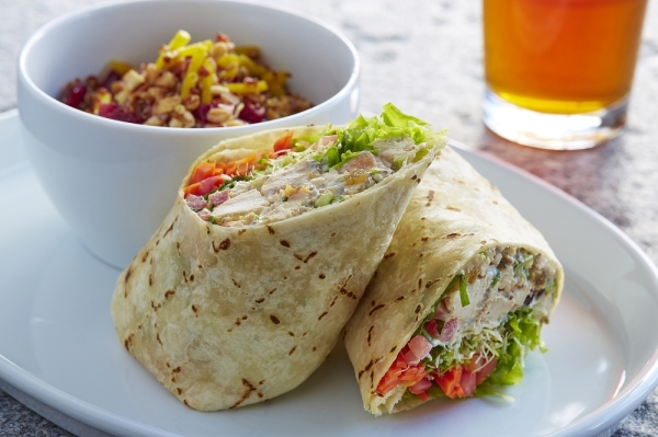 Flatbread wrap with sides on a white plate