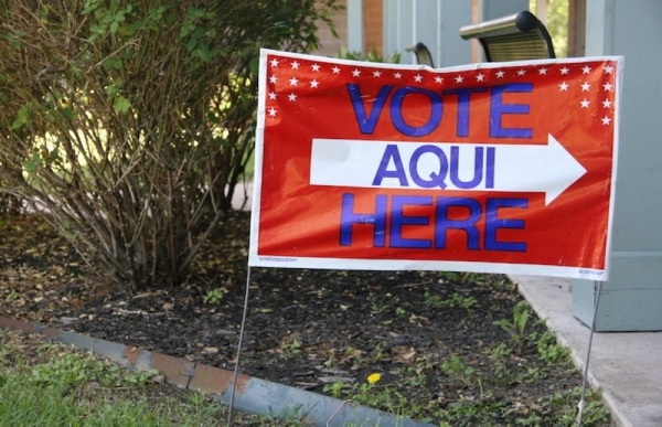 A voting sign in English and Spanish