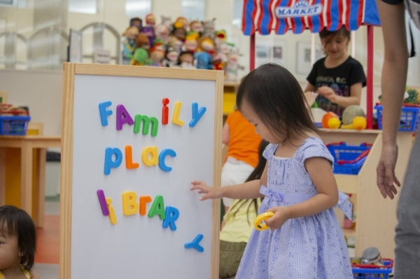 A young girl plays with magnets at the George and Barbara Bush Family Place grand opening at Lone Star College-Tomball Community Library on Oct. 15.