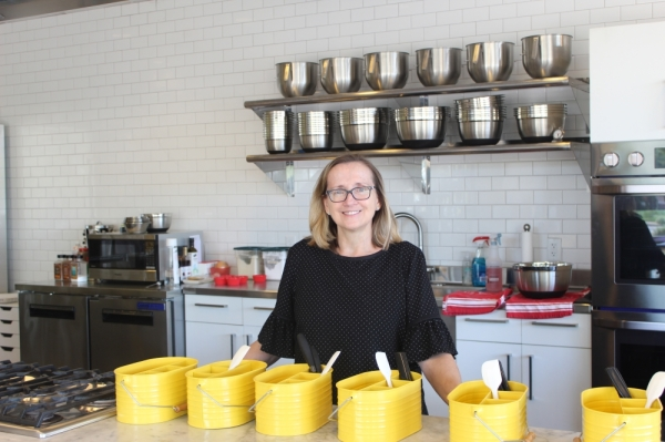 Mix Cooking School owner Marcy Makoviecki stands in the center of the island where she teaches classes to Chandler community members. (Alexa D'Angelo/Community Impact Newspaper)