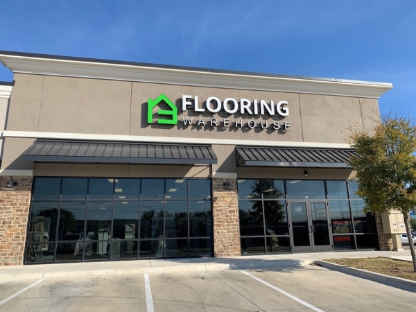 A photo of the storefront for Flooring Warehouse.