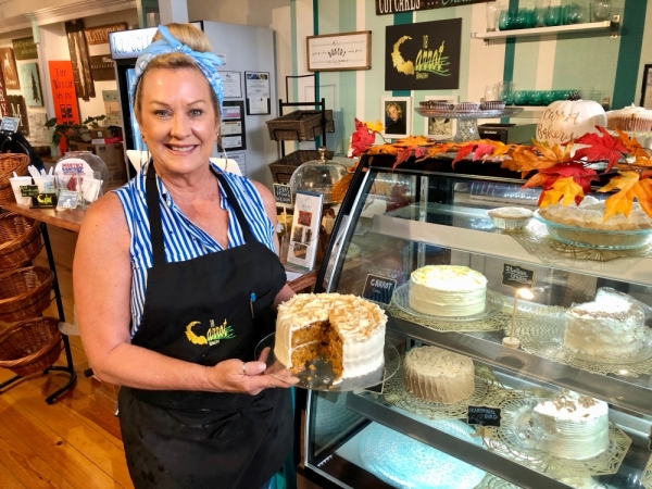 18 Carrot Bakery owner Shari Cahil poses with her signature carrot cake. (Sally Grace Holtgrieve/Community Impact Newspaper)