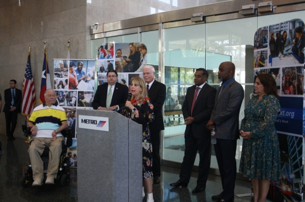 Carrin Patman (center), board chairperson of the Metropolitan Transit Authority of Harris County, thanks voters for supporting a $3.5 billion bond referendum at a Nov. 6 press conference. (Shawn Arrajj/Community Impact Newspaper)