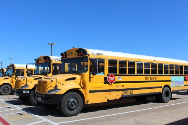 a row of big yellow school buses