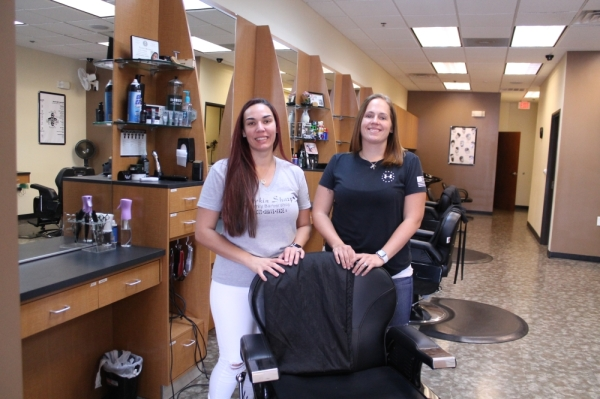 Michelle Bronson (left) and Sinead Shirley run Lookin Sharp Family Barbershop in Frisco. (Lindsey Juarez Monsivais/Community Impact Newspaper)
