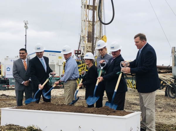 New Braunfels Utilities CEO Ian Taylor, second from left, is joined by local dignitaries, including Senator Donna Campbell and Mayor Barron Casteel, to celebrate the groundbreaking of an NBU aquifer storage and recovery well Oct. 28. (Ian Pribanic/Community Impact Newspaper)