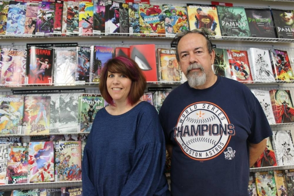Manager Shannon Vinecke and owner Robert Aranguren run Cards and Comics Connection. (Andy Li, Community Impact Newspaper.)