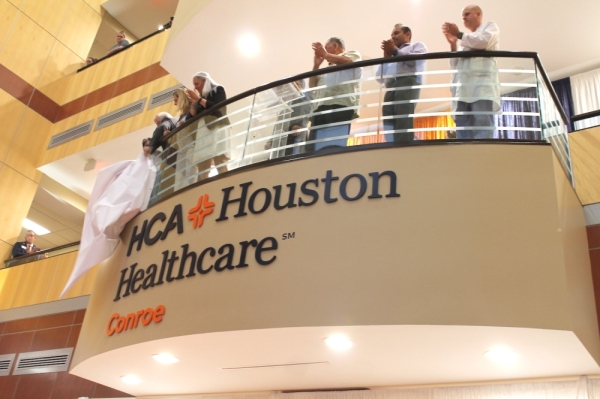 The HCA Houston Healthcare Conroe board of trustees unveils the hospital's new sign June 25. (Andy Li/Community Impact Newspaper)