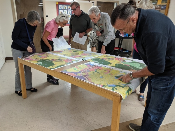 Community members examine updated zoning maps at land development code town hall in October.
