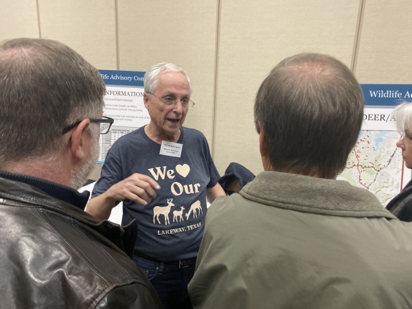 Lakeway Wildlife Advisory Committee member Ted Windecker talks with resident Tom Kilgore and Comprehensive Plan Steering Committee Chair Larry Harlan about where in the city incidents with deer are most prevalent.