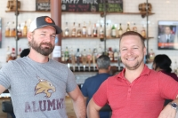 Cody Taylor (left) and Harlan Scott said the most surprising and rewarding thing about owning their own restaurant has been the opportunity to mentor their 30-40 employees.  (Anna Daugherty/Community Impact Newspaper)