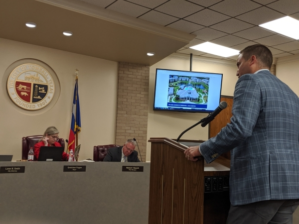 Eric Overton presented to Tomball City Council on Nov. 18 about a proposed DHI Communities mixed-use development on FM 2920. (Anna Lotz/Community Impact Newspaper)