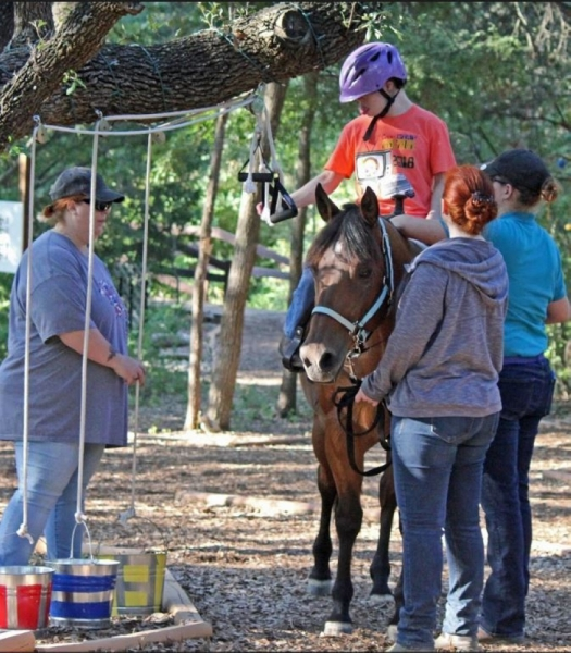 Open My World offers therapeutic horseback riding. (Courtesy Open My World Therapeutic Riding Center)
