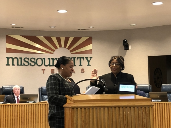 Cheryl Sterling takes the oath of office administered by Mayor Yolanda Ford at the Nov. 18 Missouri City City Council meeting. (Claire Allbright/Community Impact Newspaper)
