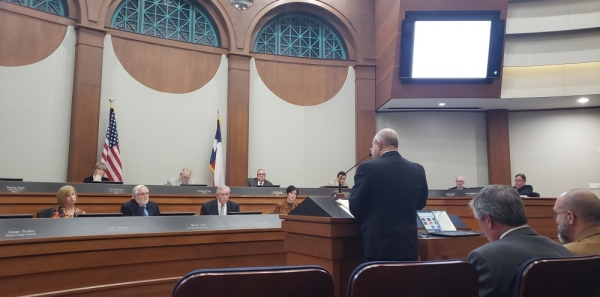 Attorney Jonathan Vinson presents a plan to extract parking spaces from a development and redevelop them for office and retail near Grapevine Mills mall. (Miranda Jaimes/Community Impact Newspaper)