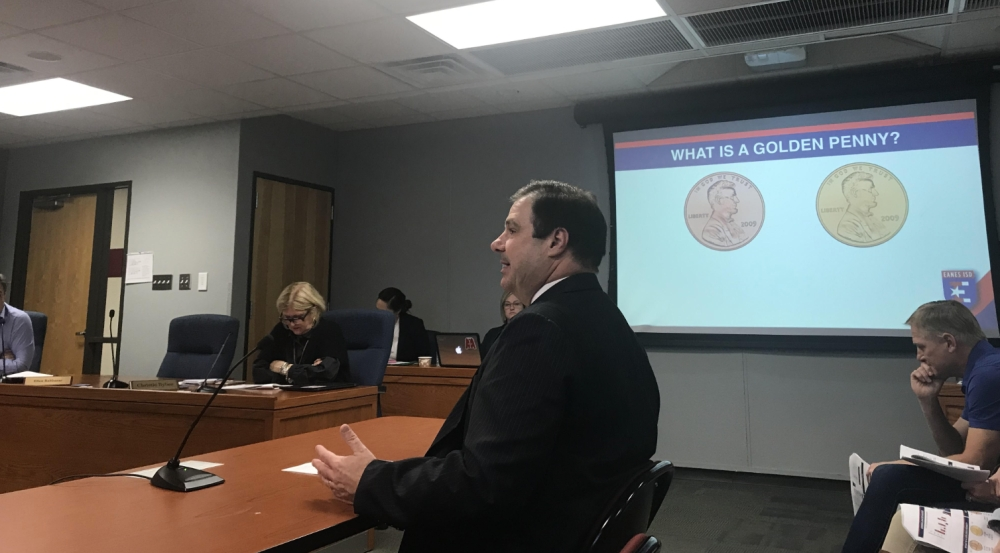 Eanes ISD Chief Financial Officer Chris Scott presents an overview to the board of trustees regarding the budget ramifications of House Bill 3. (Amy Rae Dadamo/Community Impact Newspaper)
