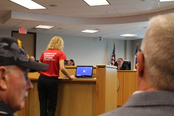 Resident Holly Novak spoke against the resolution as veterans listen. (Eva Vigh/Community Impact Newspaper)