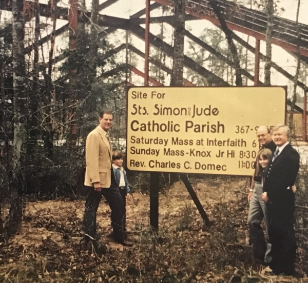 Parishioners including Msgr. Charles Domec, third from right, gather near the construction site of the Sts. Simon and Jude Catholic Parish church building in The Woodlands in 1980. Courtesy Sts. Simon and Jude Catholic Parish