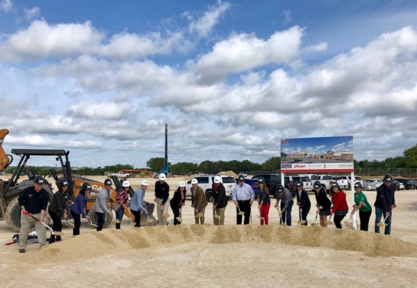 Lake Travis ISD board members and administration, elected officials and other community members broke ground April 16 on Rough Hollow Elementary School. (Sally Grace Holtgrieve/Community Impact Newspaper)