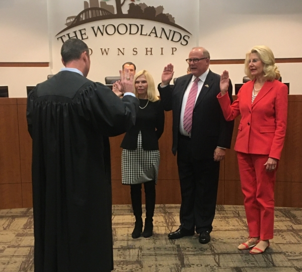 From left: Justice of the Peace Matt Beasley administered the oath of office to Woodlands Township directors Ann Snyder, Bob Milner and Shelley Sekula-Gibbs. Vanessa Holt/Community Impact Newspaper