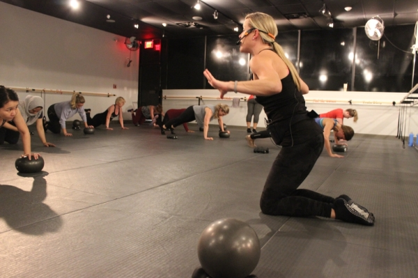 Julie Godfrey provides instructions for a fitness class at The Barre Code in Plano. (Daniel Houston/Community Impact Newspaper)