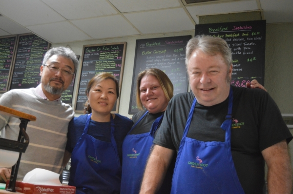 From left: Raymond and Cindy Choi took over Garden Spot Cafe in August 2016. Nicole Crow joined the team shortly thereafter, and Richard Ellis has been cooking at the deli since 2001. (Iain Oldman/Community Impact Newspaper)