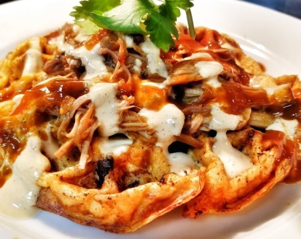 The Craft Grill Breakfast Club will serve Southern-style breakfast items such as the pulled pork-topped waffle omelet. Courtesy Craft Grill