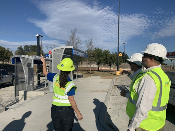 From left: A worker shows Capital Metro President and CEO Randy Clarke and Travis County Commissioner Jeff Travillion the upgrades to the Norwood Transit Center. (Courtesy Capital Metro)
