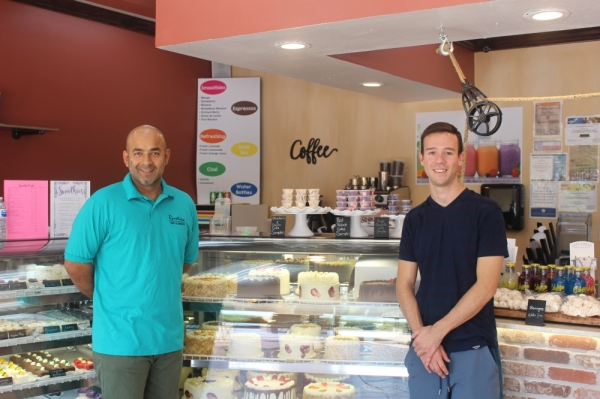 Sugar Land store manager Imtiaz Arshad (right), and Rustika Group CEO Marco Ruznick (left), who is the son of Rustika's owners, pose at the Sugar Land location.
