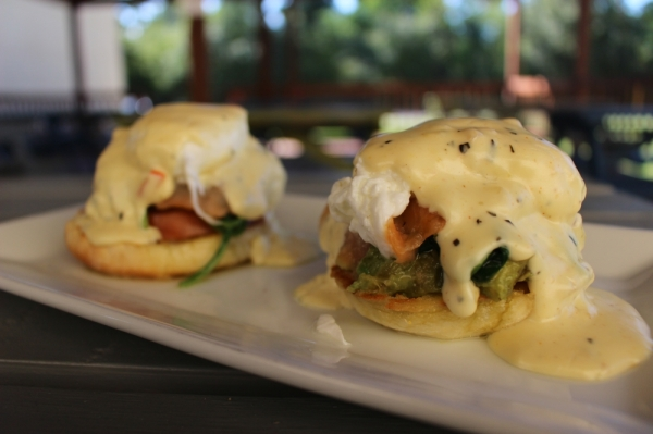 Smoked salmon, sauteed spinach, tomato slices and avocado are served on top of English muffin halves with two poached eggs and Cajun hollandaise sauce to create the Smoked Salmon Benedict ($12.45). This dish is served with a choice of side.