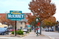 "One sign stating ""Historic Downtown McKinney Cultural District"" is on a pole near Mitchell Park. (Emily Davis/Community Impact Newspaper)"