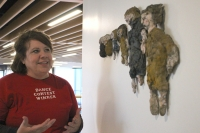 """Artist Julia Jalowiec talks about her sculpture """"Evolution of Sisters,"""" which depicts the growth of her and her own sister. (Renee Yan/Community Impact Newspaper)"""
