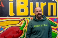 James Beck, owner of Houston's only hot sauce shop, iBurn, handpicks all of the spicy products sold at the store, located at 4227 Bellaire Blvd. (Johnny Pena/Community Impact Newspaper)