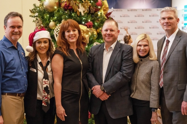 From left: Bill McGraw of Quality Home Products; Lindy Johnson, MCFB's director of development; Allison Hulett, MCFB's president and CEO; Kelly Holmes, the executive vice president and chief financial officer of Woodforest National Bank and chairman of the MCFB; Dr. Ann Snyder, community advocate; and JJ Hollie, the president and CEO at The Woodlands Area Chamber of Commerce, attended the 2018 food collection. (Courtesy Liz Grimm Public Relations)