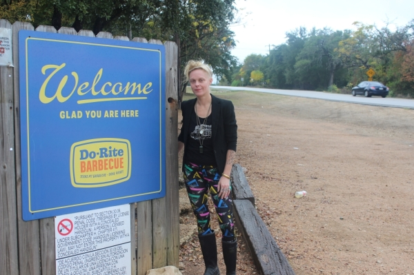 Do-Rite Director of Operations Lynn Metcalf stands by the Do-Rite welcome sign. After opening as a Stubb's satellite in 2015, Do-Rite rebranded as an independent operation in 2018.(Olivia Aldridge/Community Impact Newspaper)