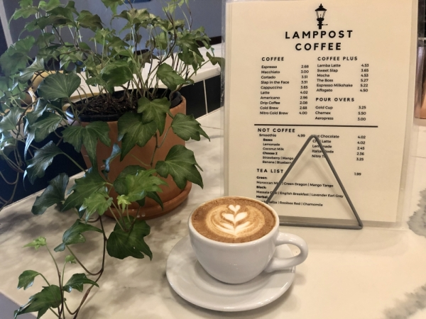 Drinks such as this cappuccino can be enjoyed on the game nights and live music events Lamppost plans to host. (Sally Grace Holtgrieve/Community Impact Newspaper)