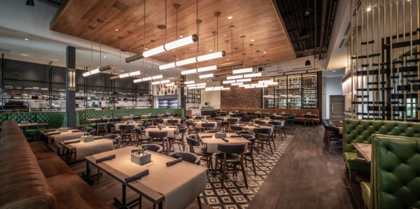 The 8,800 square-foot space includes a dining room, bar, outdoor patio and butcher room. (Courtesy Carve American Grille)