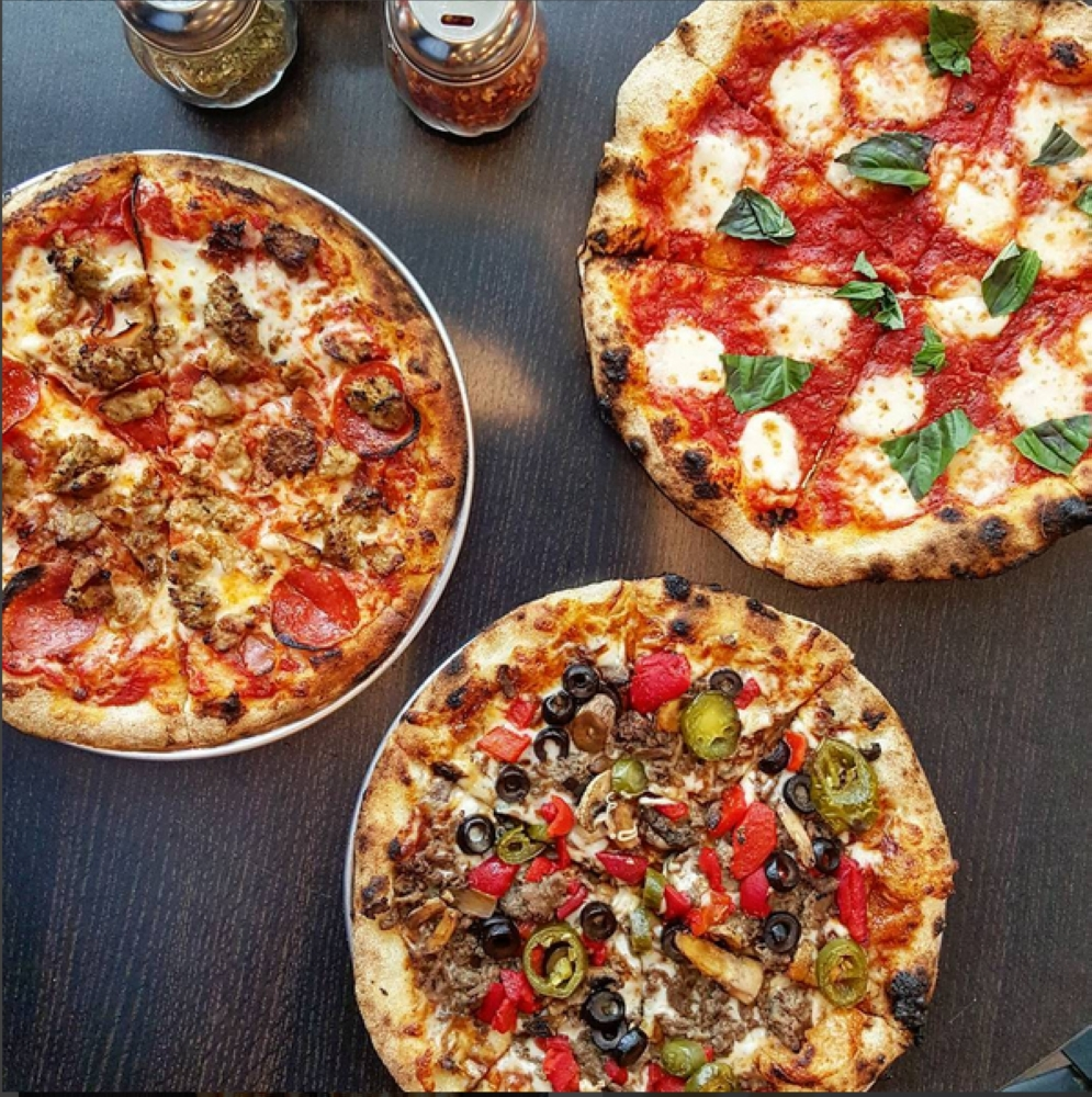The pizzeria, which specializes in Neapolitan and Roman-style pizzas, will hold its grand opening in Spring in early 2020. (Courtesy 1000 Degrees Pizza)