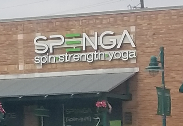 Signage is up at the new SPENGA coming to the Lakeline area. (Denise Seiler/Community Impact Newspaper)