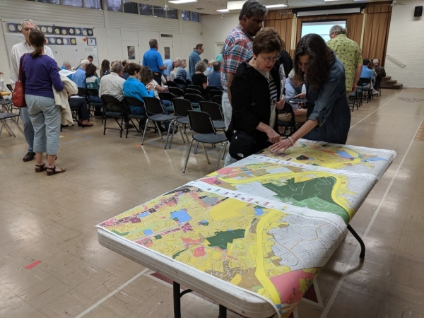 Residents in District 10 look over proposed zoning map during a meeting in October. (Iain Oldman/Community Impact Newspaper)