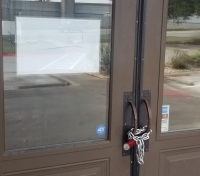 """A """"closed"""" sign is in the window of the door at the Texas Land and Cattle Steakhouse east of Lakeline Mall. (Denise Seiler/Community Impact Newspaper)"""