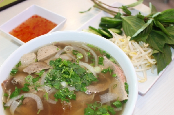 The combination pho bowl ($10.99) is served with filet mignon and meatballs in a meat-and-vegetable broth with fish sauce on the side. Ben Thompson/Community Impact Newspaper