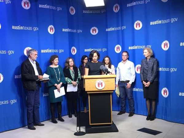 Austin Mayor Pro Tem Delia Garza, at the lectern, speaks at a November 2017 press conference. Garza filed her candidacy for Travis County attorney on Dec. 9.